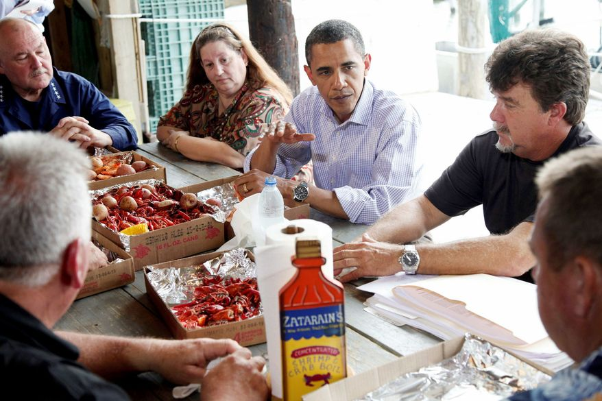 ASSOCIATED PRESS President Obama meets with area residents at Camardelle's, a seafood restaurant in Grand Isle, La., in June. Restaurant owners are hoping Mr. Obama's recent consumption of Gulf seafood will boost business and encourage residents to buy local.