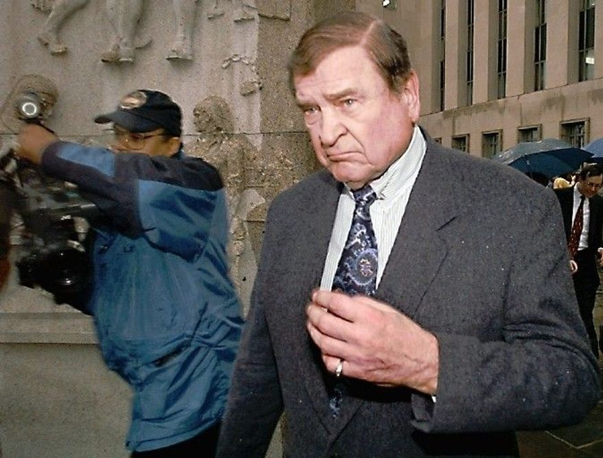 """ASSOCIATED PRESS PHOTOGRAPHS Former Rep. Dan Rostenkowski, Illinois Democrat, departs a federal courthouse in Washington on April 9, 1996, after pleading guilty to two counts of mail fraud. He was sternly told by a judge that he brought """"a measure of disgrace"""" to Congress. Rostenkowski was immediately sentenced to 17 months in prison and ordered to pay a $100,000 fine."""
