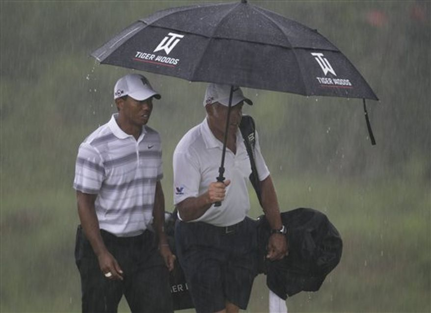 Dustin Johnson talks with rules official David Price on the 18th hole during the final round of the PGA Championship golf tournament Sunday, Aug. 15, 2010, at Whistling Straits in Haven, Wis. Johnson was later assessed a two-stroke penalty for grounding his club in a hazard on the hole.(AP Photo/Charlie Neibergall)