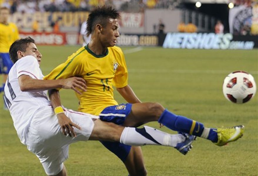 Brazil forward Neymar, right, holds off U.S. midfielder Alejandro Bedoya during the first half of an exhibition soccer match Tuesday, Aug. 10, 2010, at New Meadowands Stadium in East Rutherford, N.J. Brazil won 2-0. (AP Photo/Bill Kostroun)
