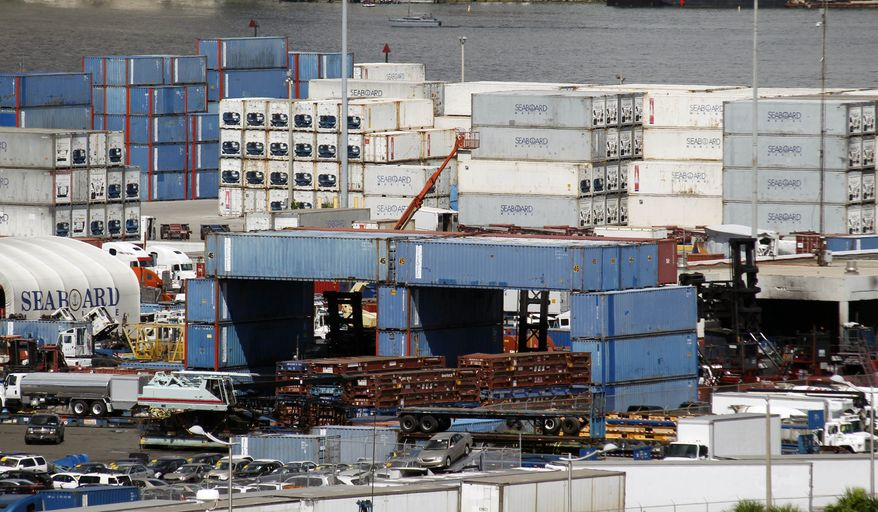 In this July 8, 2010, photo, shipping containers are off-loaded at the Port of Miami in Miami. (AP Photo/Wilfredo Lee)