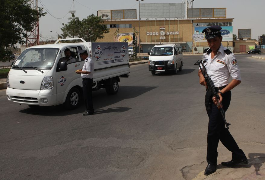 An Iraqi traffic policeman works during a sunny day on which the temperature reached 116 degrees Fahrenheit in the Azamiyah neighborhood of Baghdad on Wednesday, Aug. 11, 2010. Muslims throughout the world are observing Ramadan, the holiest month in the Islamic calendar, during which they refrain from eating, drinking, smoking and having sexual relations from sunrise to sunset. (AP Photo/Khalid Mohammed)