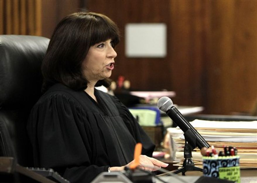FILE- In this Thursday, May 20,2010 file photo, Judge Marsha Revel speaks during a hearing in a courtroom in Beverly Hills, Calif. Revel, the judge who sent Lindsay Lohan to jail, has removed herself from the case after a prosecutor complained she improperly contacted a rehab center about the actress' court-ordered treatment. (AP Photo/Jae C. Hong, File)