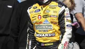 FILE - This Feb. 6, 2010, file photo shows NASCAR driver Paul Menard waiting to qualify for the Daytona 500 at the Daytona International Speedway in Daytona Beach, Fla. Paul Menard is moving to Richard Childress Racing next season, and bringing with him the sponsorship that organization needs to be a four-car team. Menard will be sponsored at RCR by his father's Wisconsin-based home improvement company. (AP Photo/Dave Martin, File)