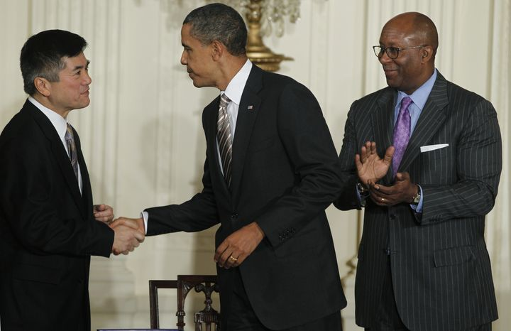 President Obama shakes hands with Commerce Secretary Gary Locke as U.S. Trade Representative Ron Kirk looks on after Mr. Obama signed the Manufacturing Enhancement Act of 2010 in the East Room of the White House in Washington on Wednesday, Aug. 11, 2010. (AP Photo/Charles Dharapak)