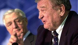 ** FILE ** Former Illinois Rep. Dan Rostenkowsi (right) and former Vice President Walter F. Mondale discuss the legacy of the late Chicago politician Richard J. Daley in 2005 at a 50th-anniversary celebration marking the start of Daley's long tenure as mayor. (AP Photo/Charles Rex Arbogast, File)