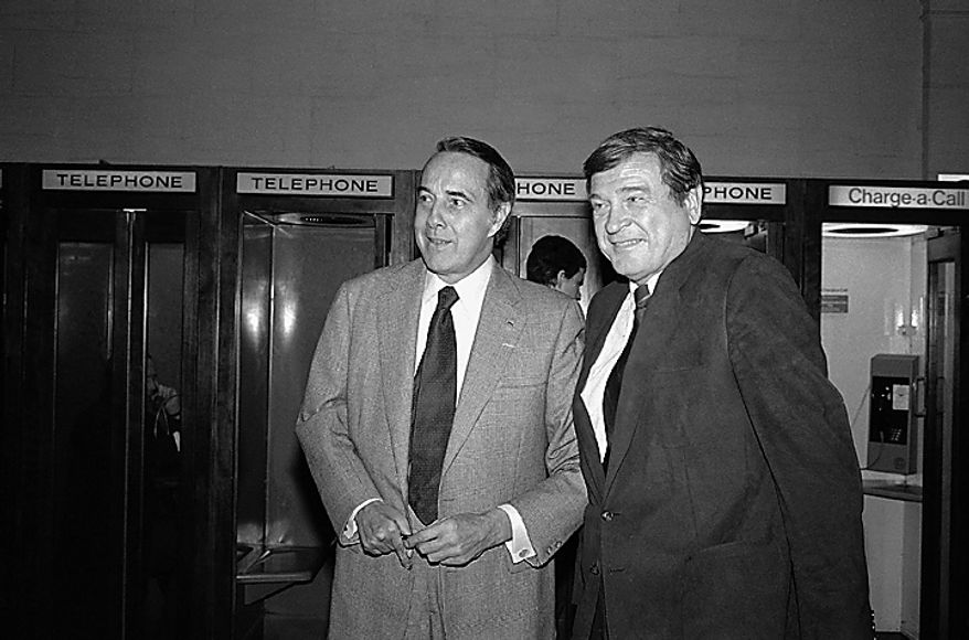 ** FILE ** Rep. Dan Rostenkowski (right), then-chairman of the House Ways and Means Committee, and Sen. Robert Dole, then-chairman of the Senate Finance Committee, chat outside a hearing room on Capitol Hill in Washington in 1982. (AP Photo/John Duricka)
