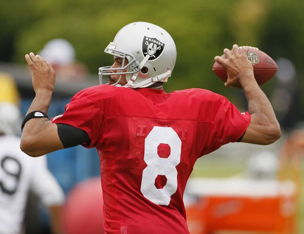 ASSOCIATED PRESS Oakland Raiders quarterback Jason Campbell throws the ball during their football training camp in Napa, Calif., Tuesday, Aug. 3, 2010.