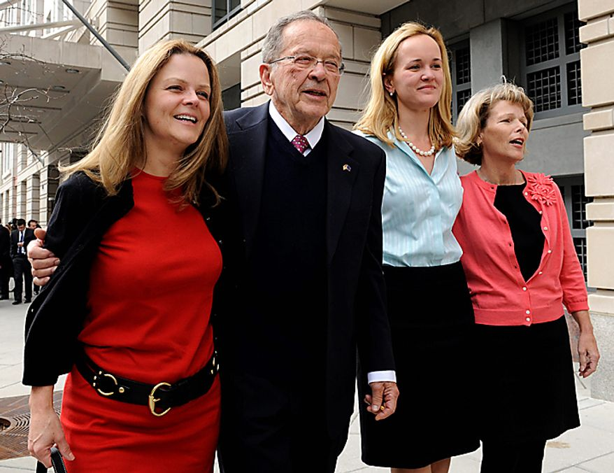 In this April 7, 2009 file photo, former Alaska Sen. Ted Stevens stands with his daughters, from left, Beth Stevens, Lily Stevens and Susan Covich as he leaves federal court in Washington. Stevens, an uncompromising advocate for Alaska for four decades who delivered scores of expensive projects to one of the nation's most sparsely populated states, died in a plane crash on Monday, Aug. 9, 2010 at the age of 86. Family spokesman Mitch Rose says Stevens was among the victims of a crash outside Dillingham, Alaska about 325 miles southwest of Anchorage. (AP Photo/Susan Walsh, File)