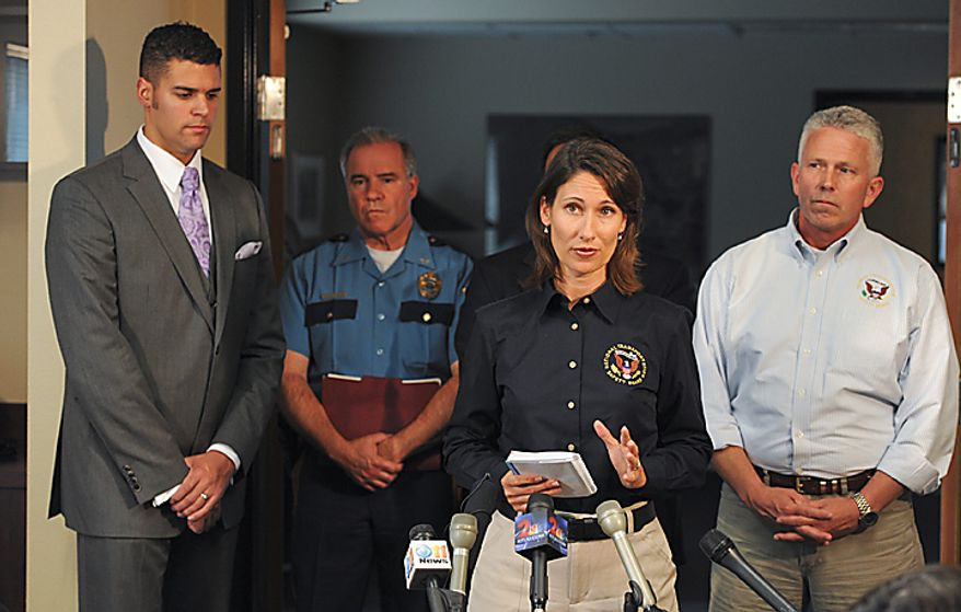 National Transportation Safety Board Chairman Deborah Hersman, center, details the aviation accident on Tuesday, Aug. 10, 2010 in Anchorage.  The plane crash took the lives of five people including former U.S. Senator Ted Stevens on August 9, 2010 near Dillingham, Alaska.  With Hersman are from left,  McHugh Pierre of the State of Alaska Department of Military and Veteran Affairs,  Colonel Audie Holloway of the Alaska State Troopers and NTSB Investigator Clint Johnson.   ( AP Photo/Michael DInneen)