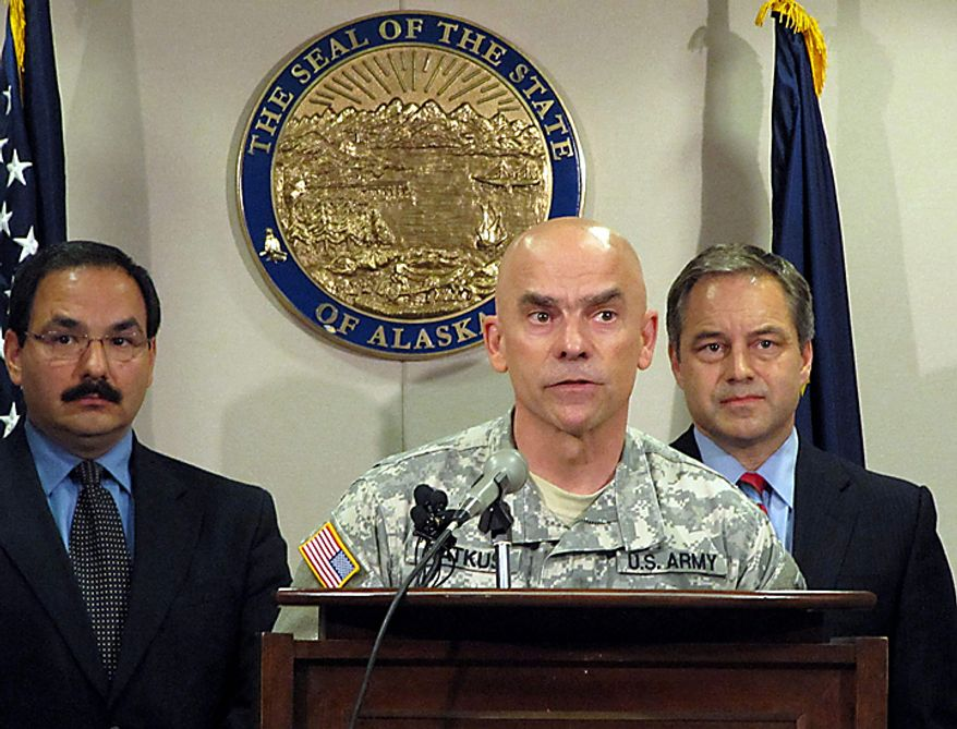 Maj. Gen. Thomas Katkus, center, adjutant general of the state Department of Military and Veterans Affairs, Alaska Gov. Sean Parnell , right, and Public Safety Commissioner Joe Masters, speak at a news conference about the plane crash that killed former Sen. Ted Stevens. The plane carrying Stevens and ex-NASA chief Sean O'Keefe crashed into a remote mountainside in Alaska, killing the longtime senator and a number of others, authorities said Tuesday. (AP Photo/Rachel D'oro)