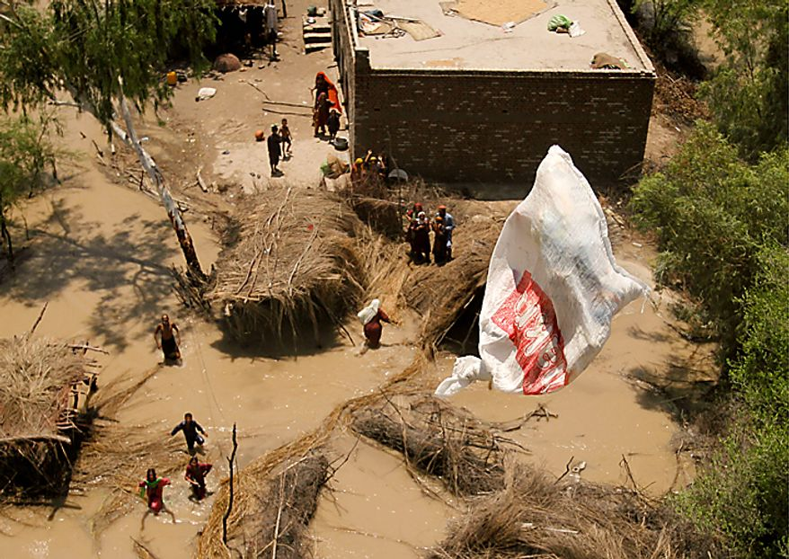 Pakistani villagers chase relief supplies dropped from a Pakistani navy helicopter at a flooded area of Ghaus Pur near Sukkur, in Pakistan's Sindh province, Wednesday, Aug. 11, 2010. The U.N., relying on Pakistani figures, said the number of people affected by flooding over the past two weeks is 13.8 million, more than the combined total of the 2004 Indian Ocean tsunami, the 2005 Kashmir earthquake and the 2010 Haiti earthquake, although the death toll in each of those disasters was much higher than the 1,500 people killed in the floods. (AP Photo/Shakil Adil)