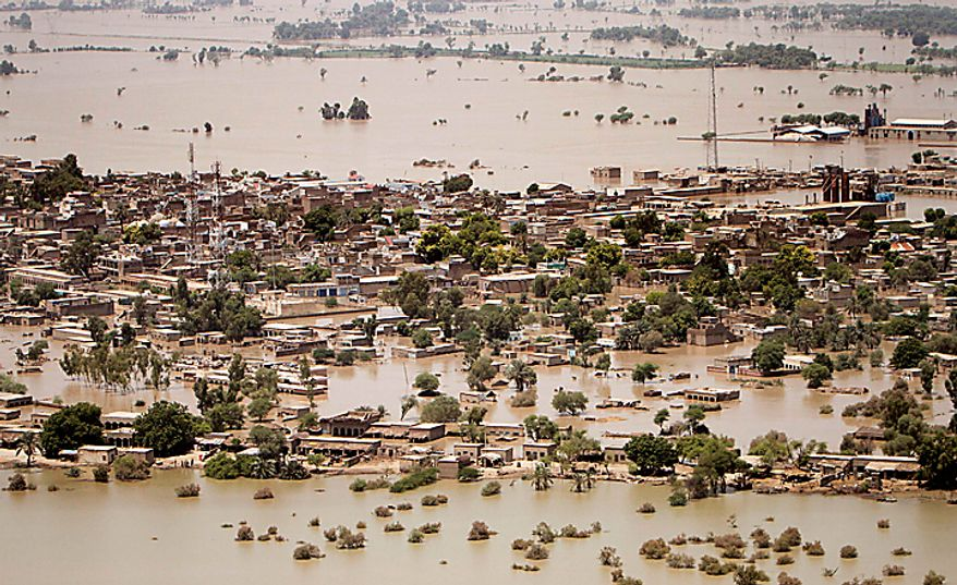 Houses are half submerged in heavy floodwater in Ghaus Pur near Sukkur, in Pakistan's Sindh province, Wednesday, Aug. 11, 2010. The U.N., relying on Pakistani figures, says the number of people affected by flooding over the past two weeks is 13.8 million, more than the combined total of the 2004 Indian Ocean tsunami, the 2005 Kashmir earthquake and the 2010 Haiti earthquake, although the death toll in each of those disasters was much higher than the 1,500 people killed in the floods. (AP Photo/Shakil Adil)