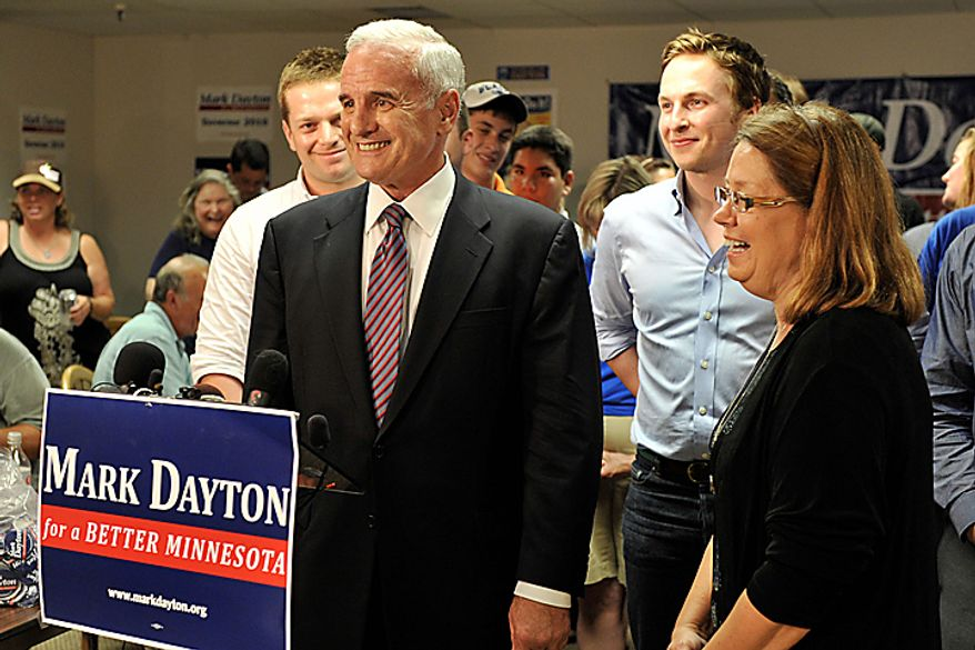 Former U.S. Sen. Mark Dayton enjoys a laugh after addressing the media with his running mate, State Sen. Yvonne Prettner-Solon, after The Associated Press called Dayton the winner of the Democratic gubernatorial primary election Tuesday night, Aug. 10, 2010 in St. Paul, Minn. Behind Dayton are his sons Eric, left, and Andrew. (AP Photo/Jim Mone)