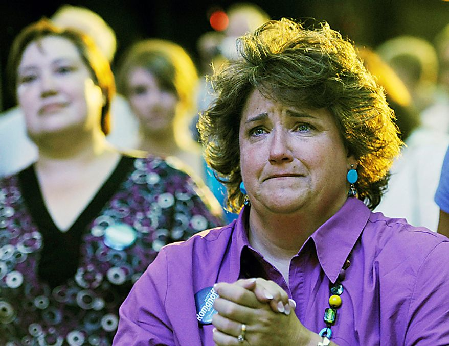 Judy Wheeler, of Fort Collins, a support of Andrew Romanoff, candidate in the Democratic Primary race for the U.S. Senate seat in Colorado cries as Romanoff concedes defeat in Denver on Tuesday, August 10, 2010. (AP Photo/Chris Schneider)