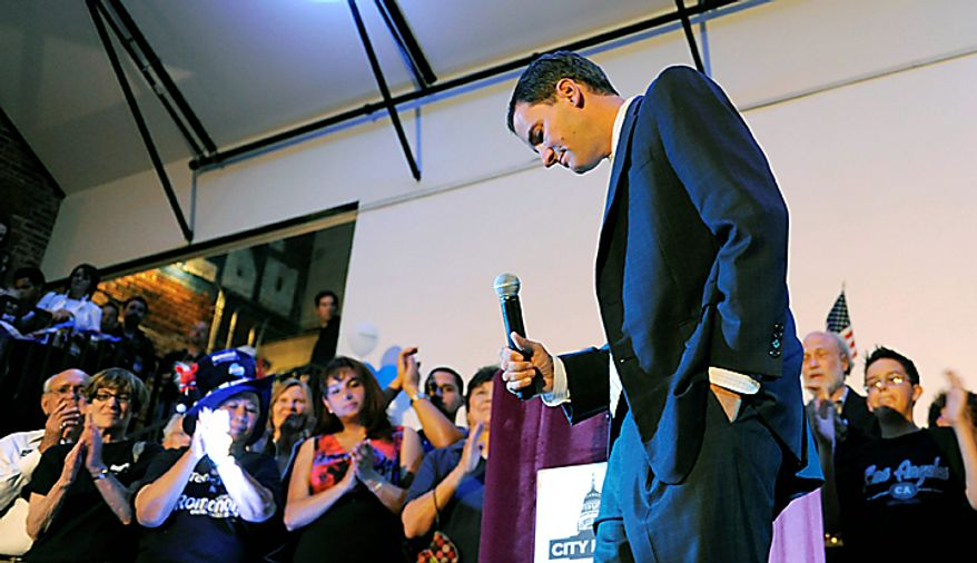 Andrew Romanoff, center, candidate in the Democratic Primary race for the U.S. Senate seat in Colorado, bows his head as supporters clap during his concession speech to incumbent Democrat Michael Bennet in Denver on Tuesday, Aug.  10, 2010. (AP Photo/Chris Schneider)