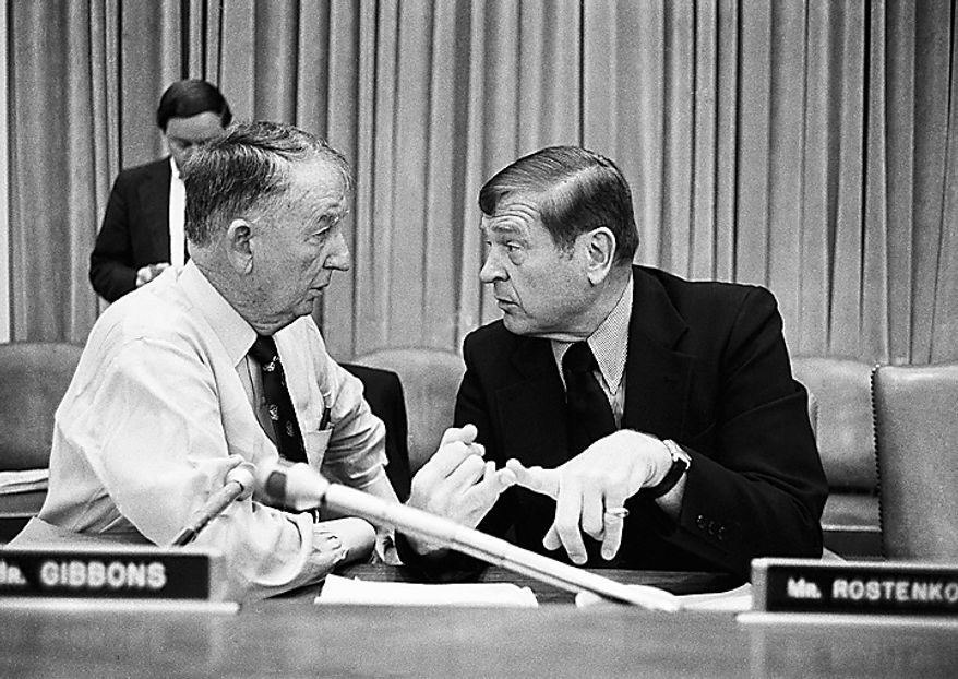 Rep. Sam Gibbons, left, D-Fla., confers with Rep. Dan Rostenkowski, D-Ill., before a meeting of House and Senate deficit conferees, Tuesday, June 20, 1984 at Capitol Hill in Washington. The negotiations stalled when House Democrats served notice they will not trim Medicare and other health programs as long as Senate Republicans seek tax breaks for business and the wealthy. (AP Photo/John Duricka)