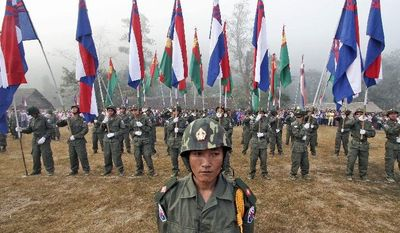 ** FILE ** Karen National Army soldiers stand in formation during Revolution Day ceremonies in Burma in January 2006. The ethnic tribesmen, a minority in Burma, fought against the Japanese in World War II, but were never given their own state as the British had promised.
