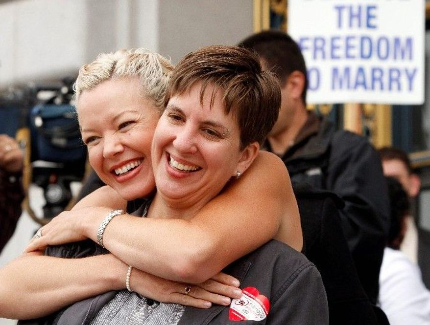 ASSOCIATED PRESS PHOTOGRAPHS Gay couple Tara Walsh (left) and Wen Minkoff embrace outside San Francisco's City Hall on Thursday. A judge put gay marriages on hold for at least six days in California, disappointing some but raising hopes that same-sex couples will soon be able to tie the knot.