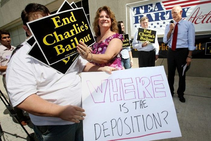 """ASSOCIATED PRESS Karen Moran of West Palm Beach, a member of the """"tea party,"""" tries to prohibit Everett Wilkinson, chairman of the South Florida Tea Party, from heckling GOP gubernatorial candidate Rick Scott on Thursday in West Palm Beach."""