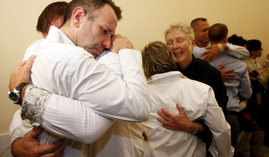 Same-sex couple Robert Huddleston, left, and Chris Holler, second from left, of San Francisco, react to the news that they may not marry for at least another week Thursday, Aug. 12, 2010, in San Francisco. A federal judge put gay marriages on hold for at least another six days in California, disappointing dozens of gay couples who lined up outside City Hall hoping to tie the knot Thursday. Judge Vaughn Walker gave opponents of same-sex weddings until Aug. 18 at 5 p.m. to get a ruling from the 9th U.S. Circuit Court of Appeals on whether gay marriage should resume. Gay marriages could happen at that point or be put off indefinitely depending on how the court rules.(AP Photo/Eric Risberg)