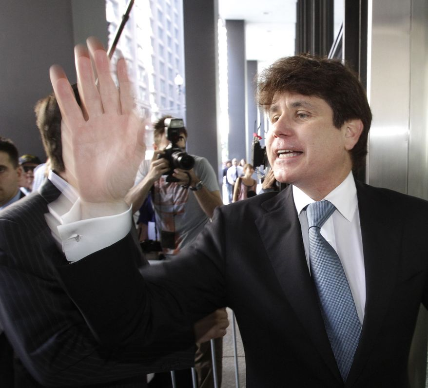 ** FILE ** Former Illinois Gov. Rod Blagojevich arrives at federal court in Chicago on Thursday, Aug. 12, 2010, as the jury continues to deliberate in his corruption trial. (AP Photo/Charles Rex Arbogast)