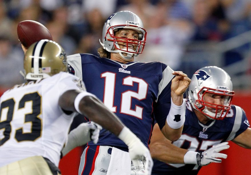 ASSOCIATED PRESS New England Patriots' Tom Brady (12) passes the ball under pressure from New Orleans Saints' Bobby McCray, left, as Patriots' Rob Gronkowski, right, blocks in the first half of an NFL preseason football game in Foxborough, Mass., Thursday, Aug. 12, 2010.