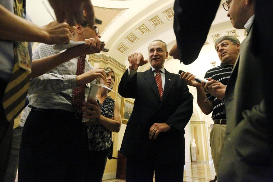Sen. Charles E. Schumer, New York Democrat, speaks to reporters on Thursday, Aug. 12, 2010, after the Senate passed a $600 million bill to pay for more law enforcement on the U.S.-Mexico border. (AP Photo/Charles Dharapak)