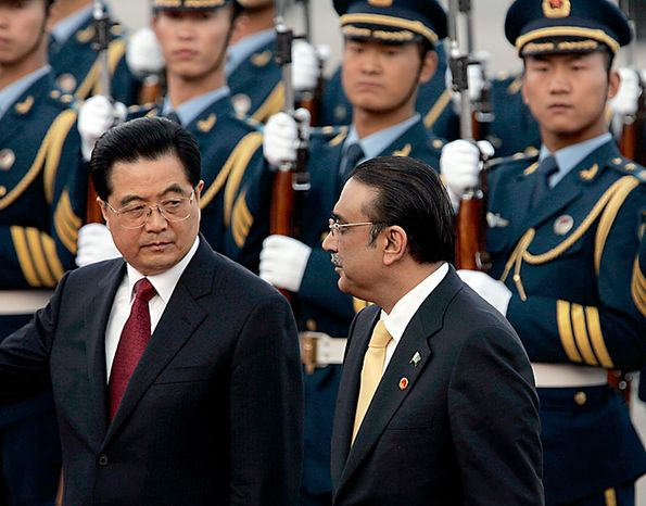 Pakistani President Asif Ali Zardari,  right, and Chinese President Hu Jintao, left,  inspect the guard of honor during a welcoming ceremony at the Great Hall of the People in Beijing , China, Wednesday, Oct.15, 2008. Zardari was to meet the leader of China in Beijing on Wednesday, as he reaches out to a close ally for increased investment to aid his country's ailing economy. A possible deal between the countries on civil nuclear power is also highly anticipated. Such an agreement would serve as a counterpoint to a recent deal between India and the United States that cleared the way for American businesses to sell nuclear fuel and technology to India for use in its civilian programs.(AP Photo/ Elizabeth Dalziel)