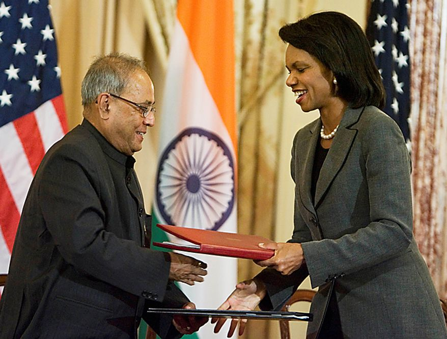 Secretary of State Condoleezza Rice and Indian Foreign Minister Pranab Mukherjee exchange documents after signing the U.S.-India Agreement for Cooperation Concerning Peaceful Uses of Nuclear Energy, during a ceremony at the State Department, Friday, Oct. 10, 2008, in Washington.  (AP Photo/Manuel Balce Ceneta)