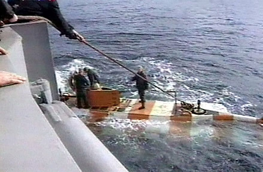 Russia rescue personnel return from a dive in a mini submarine to the Kursk on the sea bed in the Barents Sea, Friday, Aug. 18, 2000. The mini submarine was forced for unexplained reasons to surface in emergency mode after this dive. Exhausted Russian rescue workers in mini-submarines finally reached a badly mangled escape hatch on the sunken Russian nuclear submarine Friday, but failed to get into the shattered vessel or find any sign of life. (AP Photo/RTR-Russian Television Channel)