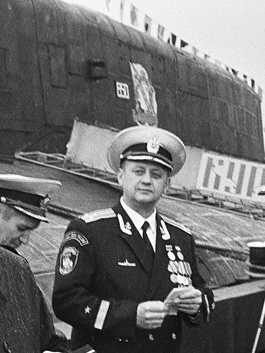 This October 1999 image shows Capt. Gennady Lyachin, the Kursk nuclear submarine commander, as he poses in front the ship at the naval base in Vedyayevo. The Hero of the Russian order, one of the country's highest honors, was awarded to Lyachin Saturday. Two weeks after the Kursk sank in the Barents Sea, Russian President Vladimir Putin conferred posthumous state honors on the 118 men.  (AP Photo/str)