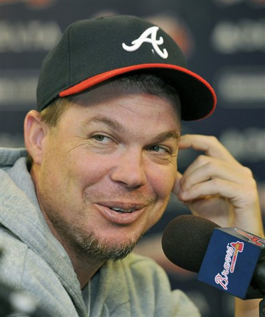 Atlanta Braves third baseman Chipper Jones smiles as he speaks during a news conference where Jones discussed his injury and future with media, Friday, Aug. 13, 2010, at Turner Field in Atlanta. (AP Photo/Gregory Smith)