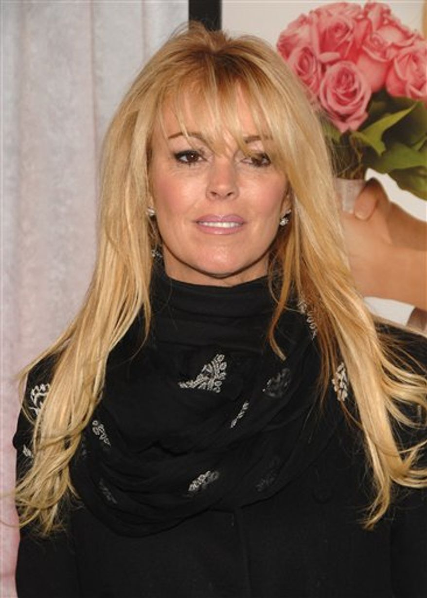 "FILE - In a Monday, Jan. 5, 2009 photo, Dina Lohan attends the premiere of ""Bride Wars"" in New York. Dina Lohan said on NBC's ""Today"" show Friday, August 13, 2010, that her duaghter Lindsay Lohan will be moving from California and back to New York. Lindsay Lohan served 14 days of a 90-day jail sentence for violating her probation in a 2007 drug case. She was sent to a UCLA drug rehab facility. Her mother says she'll be out soon. (AP Photo/Peter Kramer, File)"