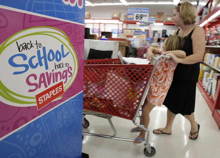 In this Aug. 1, 2010, Ann Brown, right, and her daughter Julie Anne, 5, shop for school supplies at a Staples store in Little Rock, Ark. Retail sales managed a modest increase in July after two consecutive declines, but the strength was concentrated in higher sales of autos and gasoline. Most other retailers saw their sales fall. (AP Photo/Danny Johnston)