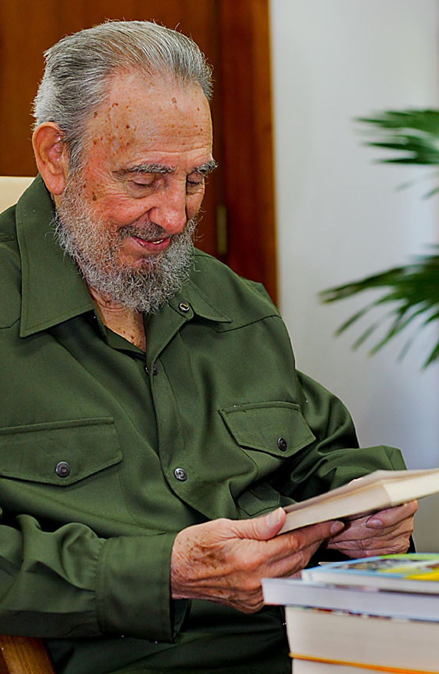 In this photo released by the state media Cubadebate web site, Fidel Castro looks at a book given to him by Colombia's Senator Piedad Cordoba, not pictured, in Havana, Cuba, Thursday Aug. 12, 2010. Castro turns 84 on Friday. (AP Photo/Cubadebate, Alex Castro)