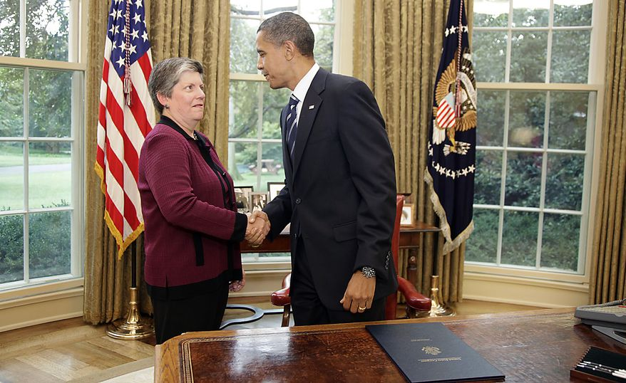 Homeland Security Secretary Janet Napolitano shakes hands with President Barack Obama in the Oval Office of the White House in Washington, Friday, Aug. 13, 2010, after he signed the Southwest Border Security Bill. (AP Photo/Carolyn Kaster)