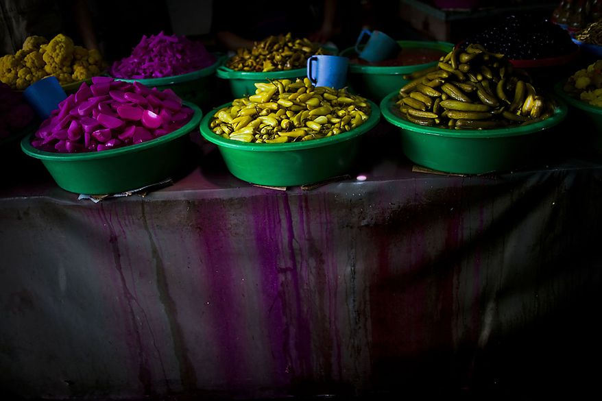 Pickle products are displayed in the Old City of the West Bank city of Hebron, Thursday, Aug. 12, 2010. Devout Muslims refrain from eating, drinking and smoking from dawn to dusk during Ramadan, a time of heightened religious fervor. (AP Photo/Bernat Armangue)