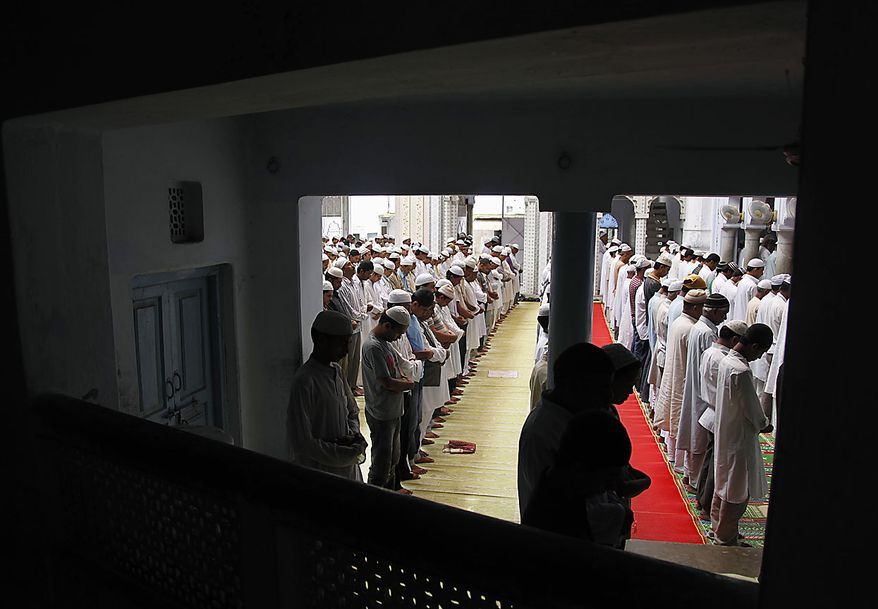 Indian Muslims pray at at a mosque in Allahabad, India, Friday, Aug. 13, 2010. Muslims throughout the world are marking the month of Ramadan, the holiest month in Islamic calendar where observant fast from dawn till dusk. (AP Photo/Rajesh Kumar Singh)