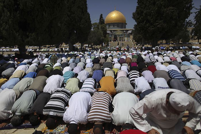 ** FILE ** Muslim worshippers pray during the first Friday prayers of the holy fasting month of Ramadan in the Al-Aqsa Mosque compound as the Dome of the Rock Mosque is seen in the background, in Jerusalem's Old City on Friday, Aug. 13, 2010. (AP Photo/Muhammed Muheisen)
