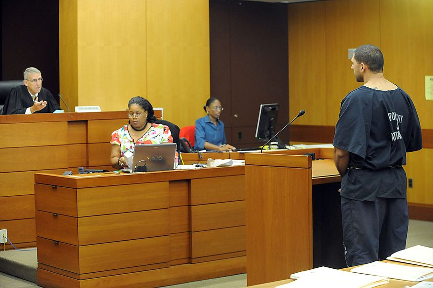 Elias Abuelazam, 33, right, attends an extradition hearing in front of Fulton County Superior Court judge Richard Hicks on Friday, Aug. 13, 2010, in Atlanta. Abuelazam, an Israeli citizen, is suspected in several stabbing attakts in Michigan, Ohio and Virginia. He was arresting at Atlanta Hartsfield Jackson International Airport before boarding a flight to Israel.(AP Photo/Erik S. Lesser-Pool)