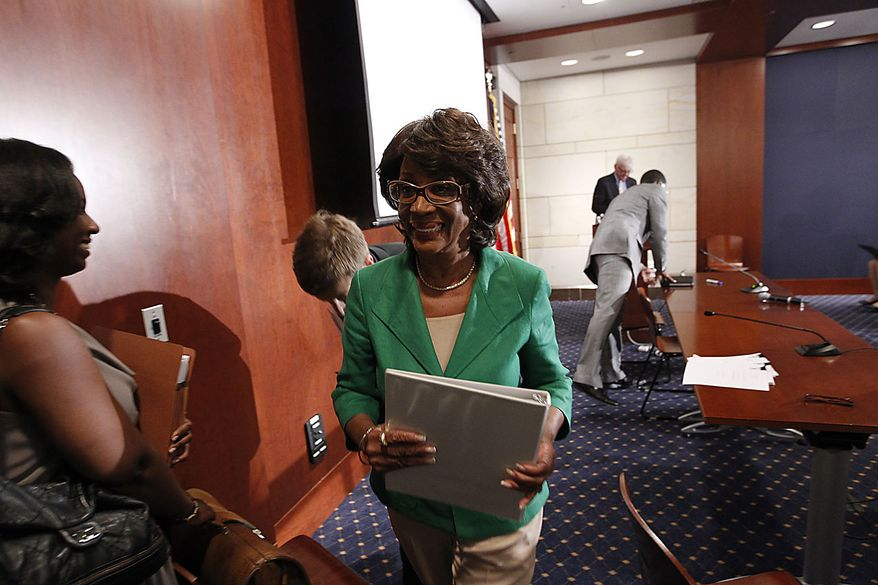 Rep. Maxine Waters, D-Calif., walks away following her news conference on Capitol Hill in Washington, Friday, Aug. 13, 2010, to discuss the House ethics committee investigation. (AP Photo/Pablo Martinez Monsivais)