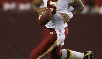 Washington Redskins quarterback Donovan McNabb scrambles during the first half of an NFL preseason football game against the Buffalo Bills in Landover, Md., on Friday, Aug. 13, 2010. (AP Photo/Alex Brandon)