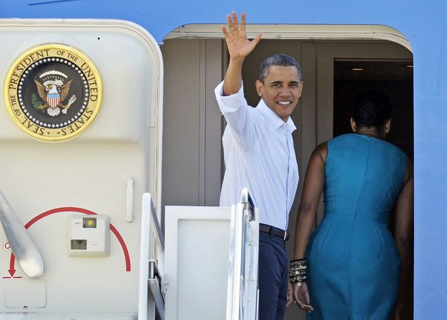 President Barack Obama waves as he and first lady MIchelle Obama board Air Force One at Andrews Air Force Base, Md., Saturday, Aug. 14, 2010, for a weekend in Panama City, Fla. The first family, absent Malia who is at summer camp, plans to spend time enjoying the area's recreational activities. But the president has also scheduled a meeting with small-business owners as the government's focus moves from plugging the oil leak to rebuilding the region's economy. (AP Photo/Cliff Owen)