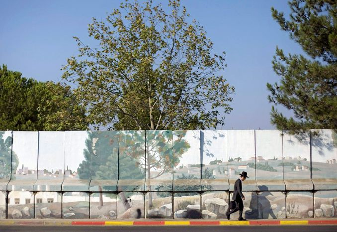 This wall helped protect the Jewish neighborhood of Gilo for nine years from the Palestinian village of Beit Jalla. (Associated Press)