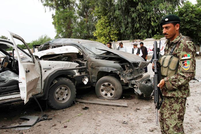 Afghans gather at the scene of an attack on a presidential adviser in Jalalabad, Afghanistan, on Aug. 2. CIA Director Leon Panetta said fewer than 100 al Qaeda operatives remain in Afghanistan, a number officials hope will restore American optimism in the ongoing war. (Associated Press)