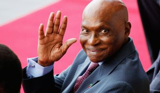 "In September 2009, Senegalese President Abdoulaye Wade gave a $200,000 farewell gift to an International Monetary Fund representative, ""in recognition to his contribution to Senegal."" (Associated Press)"