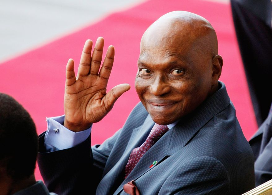 """In September 2009, Senegalese President Abdoulaye Wade gave a $200,000 farewell gift to an International Monetary Fund representative, """"in recognition to his contribution to Senegal."""" (Associated Press)"""