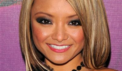 "FILE - TV Personality Tila Tequila makes an apperance at MTV Studios in Times Square for ""MTV's Tila Tequila's New Years Eve Masquerade Party 2008"", in this Dec. 31, 2007 file photo taken in New York. Hardin County Sheriff Tom Seiner says reality TV actress Tila Tequila complained that audience members pelted her with stones and feces during an outdoor music festival Saturday Aug. 14, 2010 in southern Illinois. (AP Photo/Peter Kramer, File)"