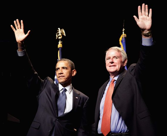 ASSOCIATED PRESS President Obama and Milwaukee Mayor Tom Barrett greet the crowd in the U.S. Cellular Arena in Milwaukee on Monday. Mr. Obama will visit several cities this week to campaign with one main message: Republicans don't solve problems.